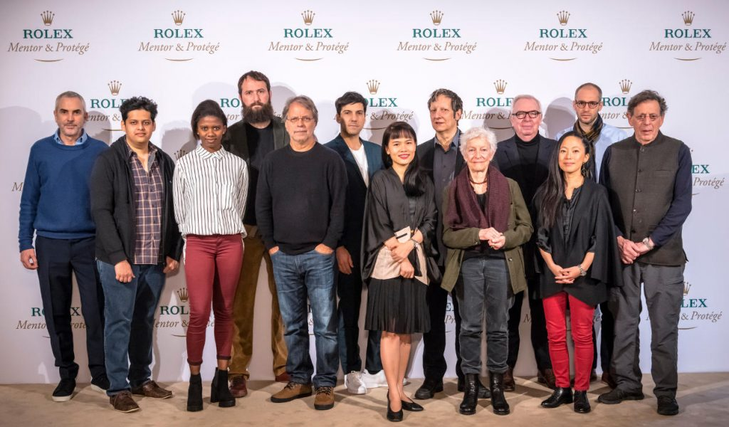 The Rolex Mentor and Protégé Arts Initiative, Press conference with the Cycle 8 (2016-2017). Left to right: Alfonso Cuarón, mentor in film, Chaitanya Tamhane, protégé in film, Londiwe Khoza, protégée in dance, Julían Fuks, protégé in literature, Mia Couto, mentor in literature, Matías Umpierrez, protégé in theatre, Thao-Nguyen Phan, protégée in visual arts, Robert Lepage, mentor in theatre, Joan Jonas, mentor in visual arts, Sir David Chipperfield, mentor in architecture, Pauchi Sasaki, protégée in music, Simon Kretz, protégé in architecture. Philip Glass, mentor in music.