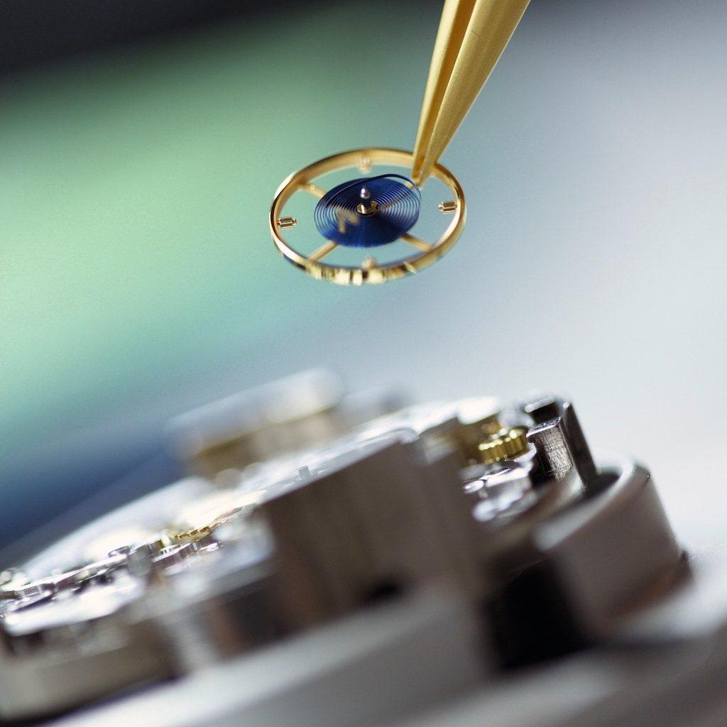 Pose du balancier - spiral dans un mouvement Rolex